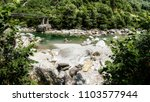 stony bed  teal water   the... | Shutterstock . vector #1103577944