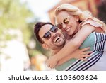 cheerful young man piggybacking ... | Shutterstock . vector #1103603624