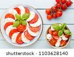 tomatoes  mozzarella cheese ...   Shutterstock . vector #1103628140