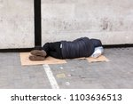 Small photo of London, United Kingdom, April 7, 2018: A homeless man sleeps on the pavement near National Museum in the centre of London. Homelessness is considered a major and growing social problem in the UK.