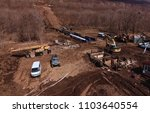 Small photo of Irkutsk, Russia - March 24, 2017: A platform with equipment for pipeline operations. Pipe penetration. Pipes of a gas pipeline, construction and laying of pipelines for transportation of gas and oil.