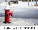 Red fire hydrant isolated with street in the background