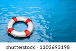 lifebuoy in the sea with... | Shutterstock . vector #1103693198