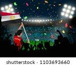 supporter hold egypt flag among ... | Shutterstock .eps vector #1103693660