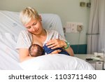 mom breastfeeding her newborn... | Shutterstock . vector #1103711480