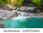 Small photo of Beautiful waterfall in autumn forest (Lad Toei) soft water of the stream in the natural park Lad Toei at Pattalung province,South Side Thailand.