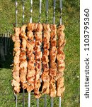 Small photo of Saslykai or shashlyk grilling on a barbecue grill over charcoal. Traditional Lithuanian summer dish usual;ly grilled in gardens