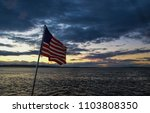 American Flag Underway At Sunset