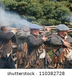 "FORT GEORGE, SCOTLAND- AUGUST 11 : Unidentified actors firing rifles during the annual ""Celebration of the Centuries"" event at Fort George, Scotland, August 11, 2012 - stock photo"
