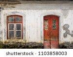 facade of abandoned building | Shutterstock . vector #1103858003