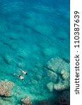couple snorkeling | Shutterstock . vector #110387639
