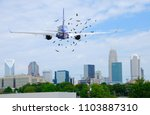 Stock photo passenger jet airliner with a flock of birds in front of it on when taking off which is extremely 1103887310