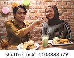 muslim couple breaking fast... | Shutterstock . vector #1103888579
