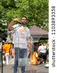 Small photo of New York, NY - June 2, 2018: Ramon Contreras speaks during Youth Over Guns March across the Brooklyn Bridge conclusion at Foley Square