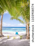 looking through tropical palm... | Shutterstock . vector #1103908574