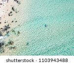 an aerial view of a surfer... | Shutterstock . vector #1103943488