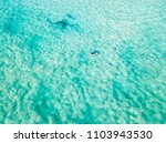 an aerial view of a surfer... | Shutterstock . vector #1103943530