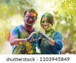 indian couple celebrating holi... | Shutterstock . vector #1103945849