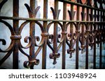forged metal fence in retro... | Shutterstock . vector #1103948924