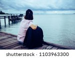 alone woman traveler sitting on ... | Shutterstock . vector #1103963300