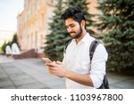 indian male student texting on... | Shutterstock . vector #1103967800