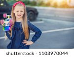 a fashionable little cute girl... | Shutterstock . vector #1103970044