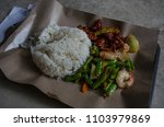 rice and pork in sweet sauce... | Shutterstock . vector #1103979869