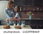 mom and daughter in casual... | Shutterstock . vector #1103998469