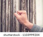 sunburned hand of a man in a...   Shutterstock . vector #1103999204