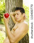 Adam holds an apple in his hand - stock photo