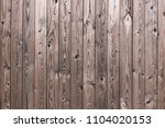 the texture of the wooden fence.... | Shutterstock . vector #1104020153