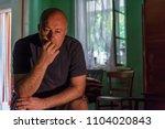depressed man sitting head in... | Shutterstock . vector #1104020843