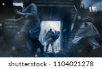 Stock photo medieval battle guards standing in the wooden fortress gates defend hillfort from viking attack 1104021278