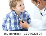 doctor and child patient.... | Shutterstock . vector #1104023504