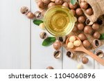 Bowl Of Macadamia Nut Oil And...
