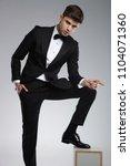 seductive businessman in black... | Shutterstock . vector #1104071360