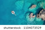 aerial view at the girl on sea... | Shutterstock . vector #1104073529