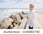 beautiful young woman enjoying... | Shutterstock . vector #1104082730