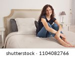 beautiful woman sitting... | Shutterstock . vector #1104082766