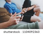 father and sons sitting on a... | Shutterstock . vector #1104092363