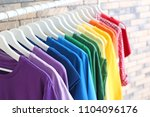 rack with rainbow clothes on... | Shutterstock . vector #1104096176