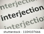 Small photo of word interjection printed on white paper macro