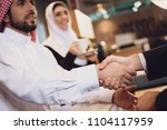 arab businessman shakes hands... | Shutterstock . vector #1104117959