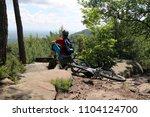 mountain biker enjoying the view | Shutterstock . vector #1104124700