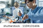 electronics engineer works with ... | Shutterstock . vector #1104131606