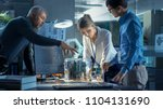 team of computer engineers lean ... | Shutterstock . vector #1104131690