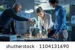 team of computer engineers lean ... | Shutterstock . vector #1104131690