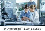 asian scientist sitting at his... | Shutterstock . vector #1104131693