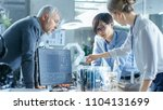 team of computer engineers... | Shutterstock . vector #1104131699
