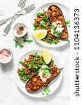 harissa roasted eggplant with... | Shutterstock . vector #1104136373